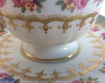 Stunning Vintage Aynsley fine bone China teacup. Light teal colour with gold guilting and Roses.