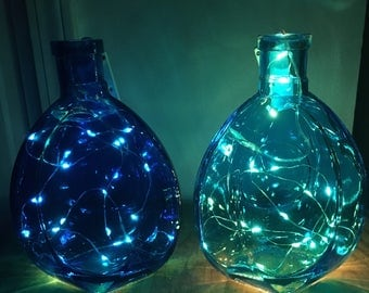 Colored glass bottle with lights