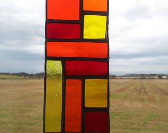 Stained Glass Geometric Sun Catcher in Yellow, Orange and Red.