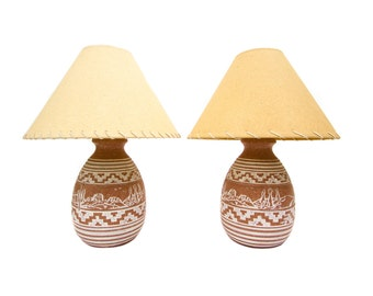 A Pair of Southwest New Mexico Incised Pottery Lamps