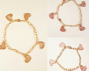 Wristband with charms in heart shape