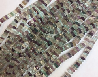 Graduated roundelle rainbow fluorite beads starting around 3.5mm going to 7.7MM!!!! These are faceted