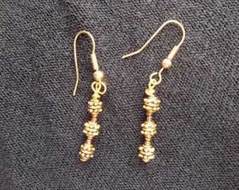 Gold and copper toned beaded dangle earrings