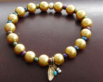 Gold Beaded Bracelet with little charms