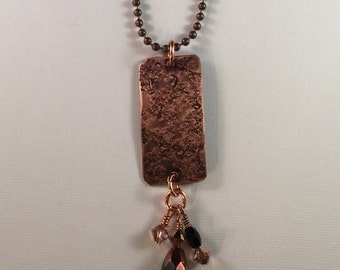 Copper with crystal pendant