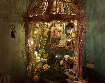 Fairy dwelling in a vintage bird cage