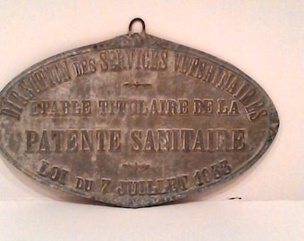 Metal plate of sanitary licence.
