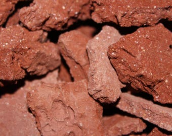 Earthy Goodies crunchy brick red clay dirt chunks. Clean, low grit and earthy clay pieces