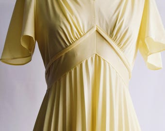 Dress long pleated party pastel yellow.