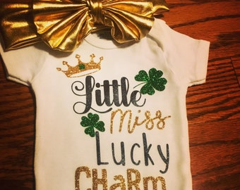 St. Patrick's Day outfit for baby girl's. Little Miss Lucky Charm St. Patty's Day shirt for toddlers and girls. Shamrock lucky onesie.