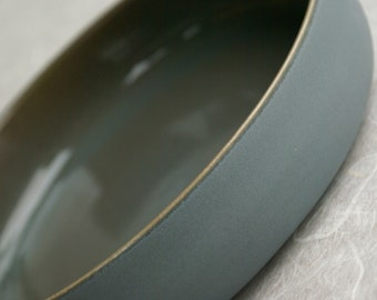 Grey plate in ceramics, beautiful as decoration or for use in the kitchen and on the table