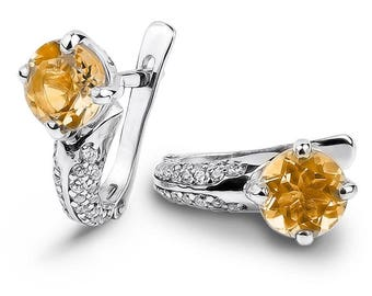 Earrings 925 sterling silver with natural citrine. Classic earrings with yellow large stone. Semiprecious stone