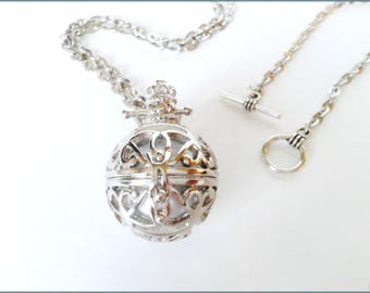 Bola clear silver metal and white musical Pearl Necklace