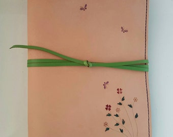 A5 Leather sleeve Journal handmade with stamped detail and a wrap around closure notebook