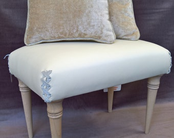 leather footstools with latticed corners and complimentary velvet cushions