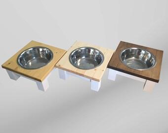 large dog, single bowl, dog feeder, table