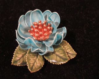 Beautiful vintage Turquoise blue and gold tone flower brooch / pin with green leaves. Lovely detail makes this piece special.