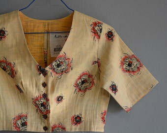 Khadi blouse - hand-spun and handwoven quilted sari blouse , comfort fit , two layered and quilted , front button opening .