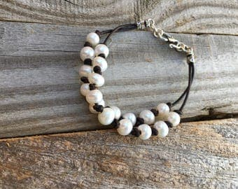 Pearl and leather knotted bracelet