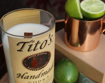 Tito's Vodka label on XL long-burning soy candle in Ginger Lime scent from repurposed bottle with a crackling wood wick