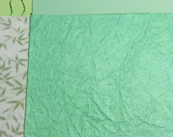 Lot of 22 green scrapbook paper