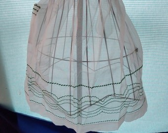 Vintage white sheer apron with green detailing