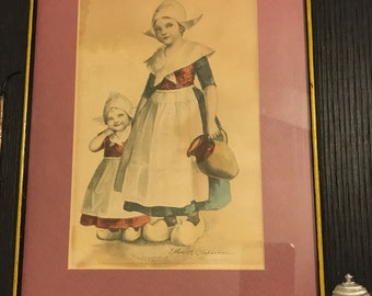 Dutch Girls Fetching Water Print By Ellen Clapsaddle in a Wood Frame copyright 1904