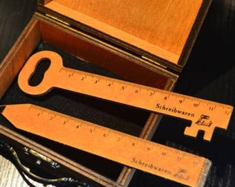 Wooden pencil-shaped rulers and vintage-style key-shaped listed here