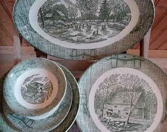 Green transferware pattern dishes with a yoke border.