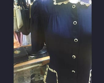 Quite adorable indeed! A 1940s WWII era dressin navy blue with adorable detailing