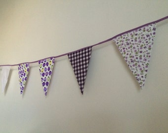 Purple with white flags line with ladybugs and flowers