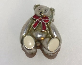 Small box Teddy bear-shaped pills. Teddy bear miniature, email collection object.