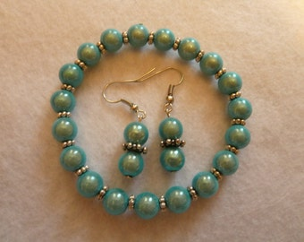 Set earring + bracelet with miracle beads in light blue