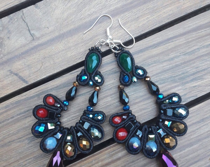 Black beautiful earrings with different colored crystals