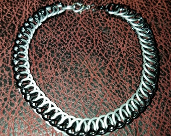 Chainmail jewelry bracelet.  Black and frost 1/2 persian.