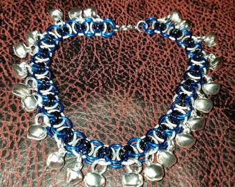 Chainmail jewelry anklet.  Blue and frost helm weave with silver bells.