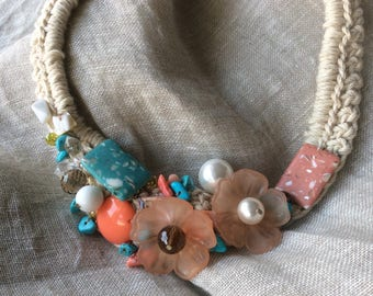 multicolored crochet necklace and stones