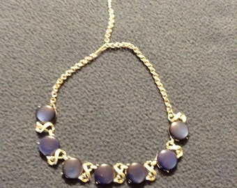 Vintage unsigned coro-style necklace in dark blue and silver tone.