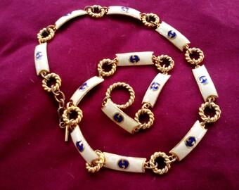 GUCCI belt, ivory enamel, gilt link belt from 1970s
