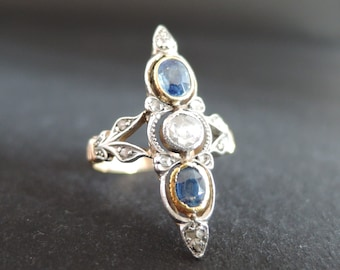 Marquise sapphires and diamonds ring.