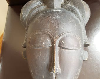 large deep mask of ladies face