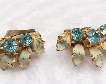 Vintage Gold Tone Painted Leaf and Blue Crystal Rhinestone Clip On Earrings Signed Austria