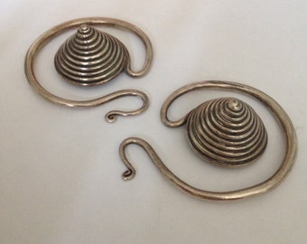 A pair of Silver Metal Earpieces. Chinese Miao Minority 19th Century