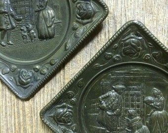 Pair of vintage english brass pictorial wall plaques embossed made in England