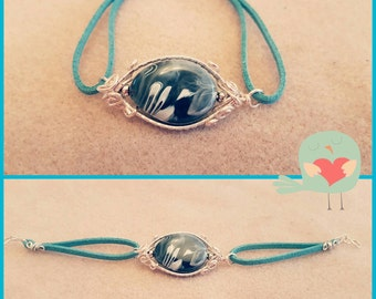 Wire wrapped bracelet on suede cord
