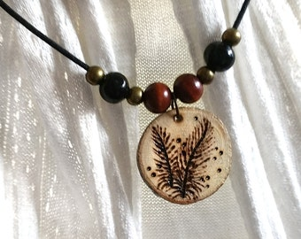 Necklace feathers, pyrography on wood of birch