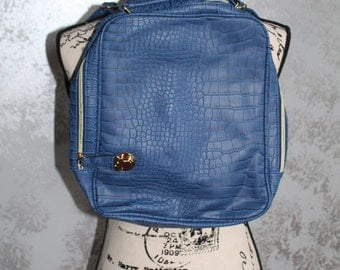 Blue leather Backpack, with gold buckle.