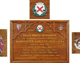 A carved oak memorial plaque