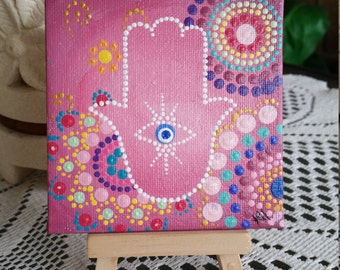 Pink Hamsa 10x10 Acrylic on canvas board. Comes with display stand.