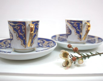 Pair of blue and white Turkish porcelain coffee cups and saucers - vintage